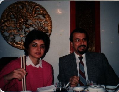 Sucheeta and Vijay dining in a restaurant in Hong Kong