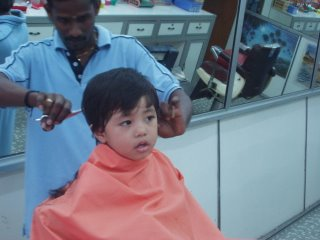 Chastan having haircut