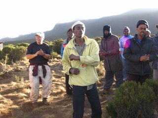singing porters and one trekker