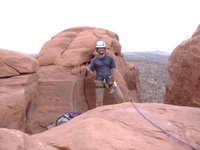 Nate Smith on top of Off Balanced Rock in Arches National Park