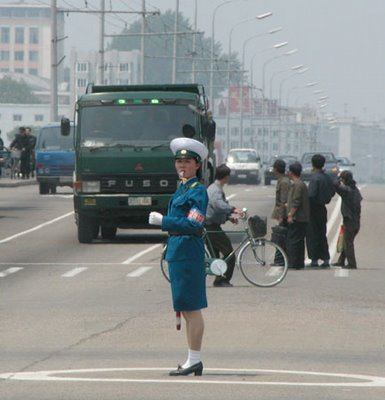 Pyongyang traffic police - by Peter Sobolev