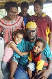 Cyclone Monica survivor, John Tabo, and family
