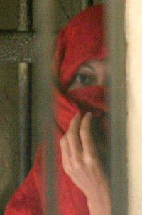 Michelle Leslie, veiled