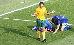 Lucas Neill protests after Fabio Grosso is awarded the penalty