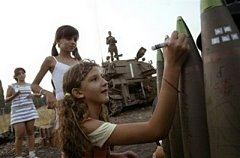 Israeli girls write on shells bound for Lebanon