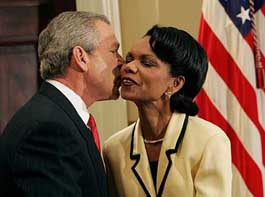 President Bush gives newly appointed Secretary of State the traditional air-kiss congratulations.