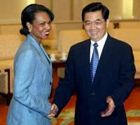 Condoleeza Rice greets Hu Jintao of China.