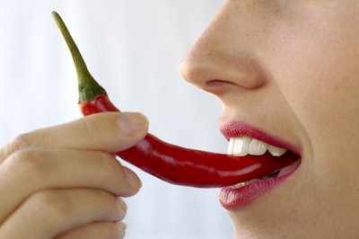 woman eating hot pepper