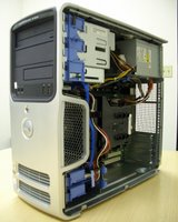 Dell Dimension 5150 with side panel removed.  Note the 12cm front fan and shroud over the CPU cooler.  Note also the rear of the case and cable management
