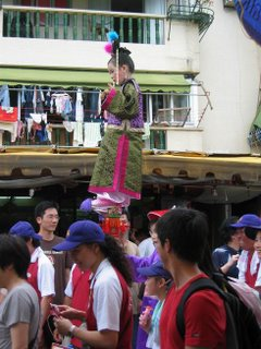 Child Floats Above the Crowd at the Cheung Chau Bun Festival