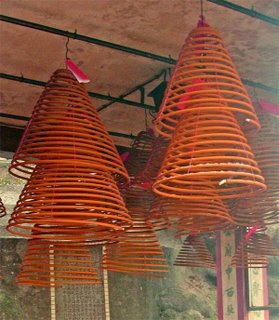 Joss spirals hanging from the ceiling of a Temple