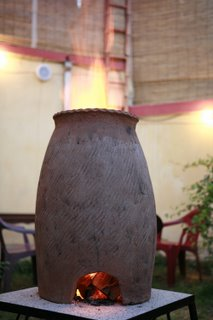 keep warm beside the clay fire pot