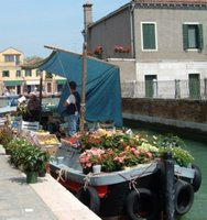 Fruit, veg and flower boat in Murano