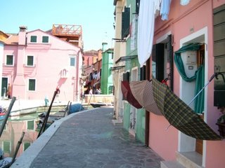 Umbrellas growing from houses on Burano