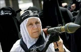 An armed Palestinian woman from the Popular Resistance Committees movement
