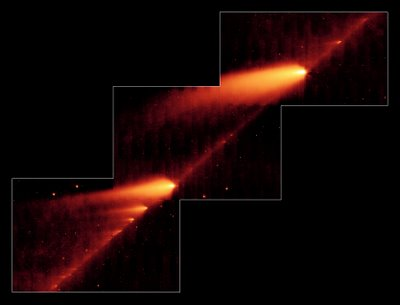 Numerous fragments of Comet Schwassmann-Wachmann 3 as seen by the Spitzer Infrared Space Telescope.  Fragment B is to the bottom left, and Fragment C is to the top right.