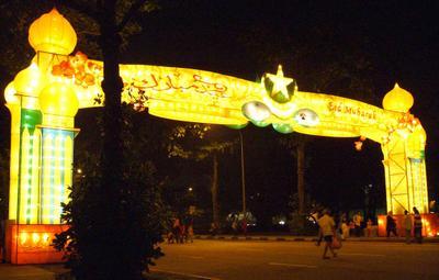The Sims Avenue Gateway to Geylang Serai, at night.