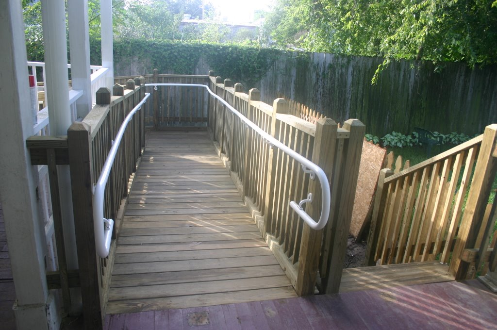Here Is The Section Of Ramp Off Of The Back Porch And The Adjoining Stairs  That The Kids Will Use To Down To The Play Area In Back Of The House.