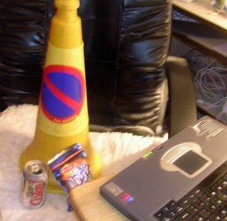 wotsits and coke. What more does a yellow cone need?