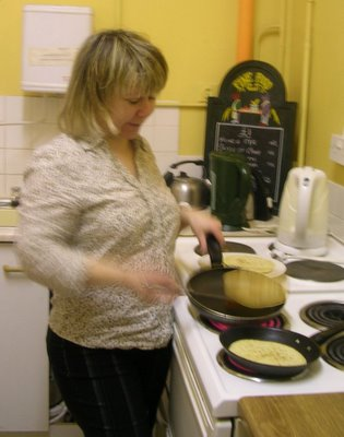 Collette tosses those pancakes... home made? yeah right!