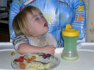 Asleep in her highchair.