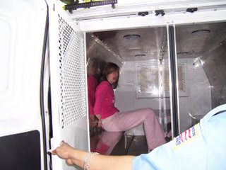 Katie in police transport van