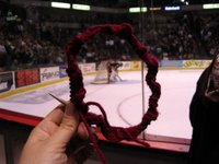 Knitting at the hockey game
