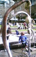Children playing around Nga Korerorero, the fountain in Midland Park