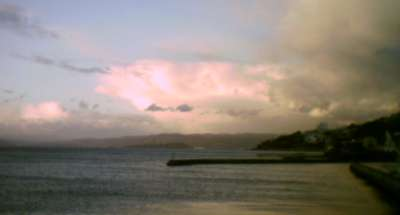 A cumulonimbus cloud seen across Wellington harbour