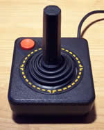Atari VCS joystick - simple stick with a single red button.