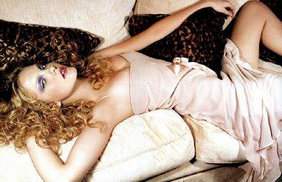 Caroline Trentini lying on a Sofa
