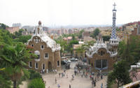 Parc Guell's gatehouse and the view across Barcelona to the sea