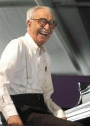 Jazz great pianist Dave Brubeck performs at the New Orleans Jazz & Heritage Festival, in this May 1, 2004, (AP file photo.)