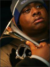 Terrell Batiste of Hot 8 Jazz band holds his horn during a performance in New York Friday, Oct. 29, 2005. Batiste grandmother, Ethel Anna Herbert, 95, is still missing after she was airlifted from the New Orleans' Superdome without her medical file after suffering a stroke. Batiste, is playing at an auction in New York Wednesday, Nov. 16, 2005 to benefit New Orleans jazz musicians dispersed around the country after the disaster. (AP Photo/Dima Gavrysh) 