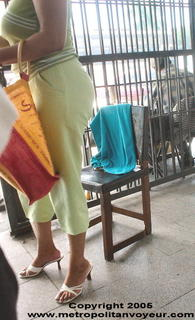 Sexy mature woman with heeled sandals selling food.