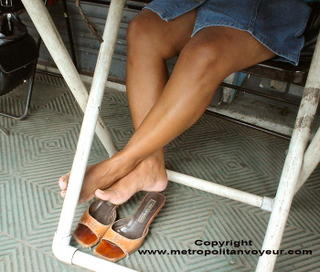 Brown legs and mules with slitted skirt. Click to see me.