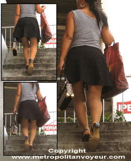 Chick climbing stairs in medium skirts and high heel sandals. Click to see larger pic !
