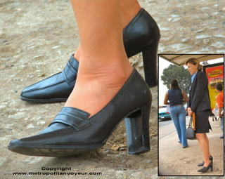Sad secretary woman using black heeled pump shoes