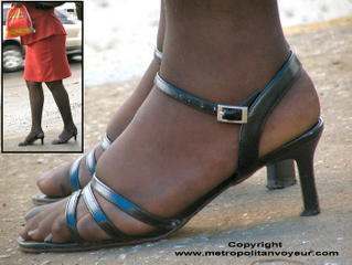 Corny feet with silky pantyhosed strap sandals. Click to view larger image.