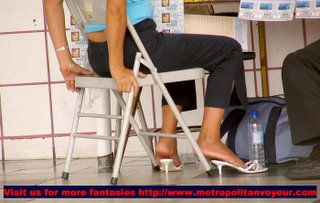 Seating nice butt lottery ticket selling woman with white 2 inches heeled mules