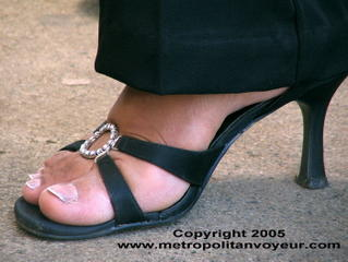 High heeled sandals with black straps and fashion costumes in the center strap