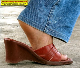 Red wedge heeled shoes with foot's arched heel.