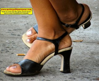 Leather black high heeled ankle strap sandals of a hard working pharmaceutical medicine reseller woman