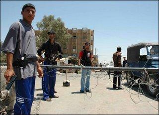 Mahdi Army militiamen at a checkpoint in Shu'la, Baghdad.