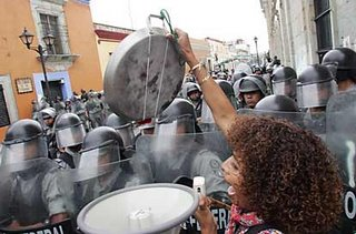 Mark in Mexico, http://markinmexico.blogspot.com/, Pale Horse Galleries for gifts, collectibles, art and crafts, http://palehorsemex.vstore.ca/, Oaxaca, Mexico: 300 APPO women march against PFP in Oaxaca's Zócalo. Woman trys to bean PFP with frying pan.