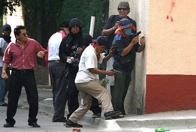 Mark in Mexico, http://markinmexico.blogspot.com/, Palehorse Galleries, http://palehorsemex.vstore.ca/, Oaxaca, Mexico: Shooters who killed American reporter Bradley Will yesterday have been identified from photos and news footage. While APPO claims otherwise, photos clearly show that APPO is armed.