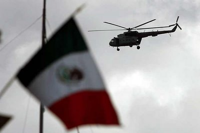 Mark in Mexico, http://markinmexico.blogspot.com/, Pale Horse Galleries, http://palehorsemex.vstore.ca/, Oaxaca, Mexico: Military helicopters and troops arrive at Oaxaca's airport this afternoon after overflying the city for two hours photographing the street blockades and other APPO concentrations.