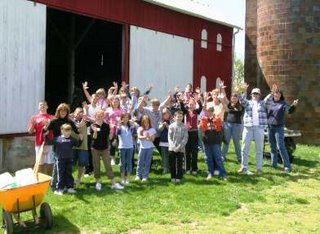 Volunteers, Staff and CSA members pose for a photograph outside Red Wiggler's barn in 2006.