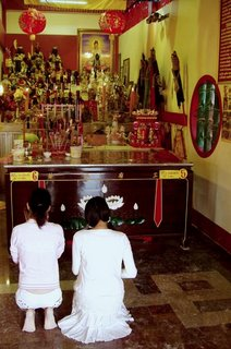 Prayers inside Sam Kong Shrine