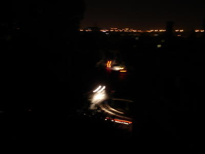 The traffic circle below my window, dark